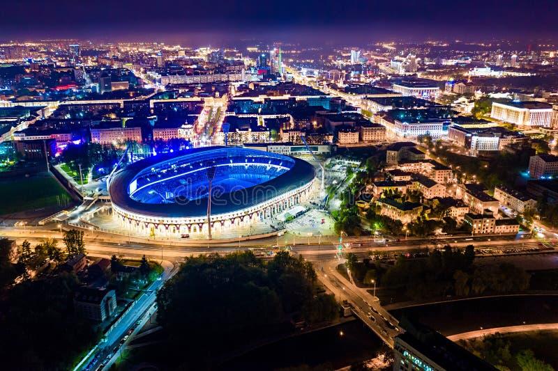 Football stadium at night holding public event. Minsk capital lit with illumination. Minsk, Belarus - May 11, 2019: Football stadium at night holding public stock photo