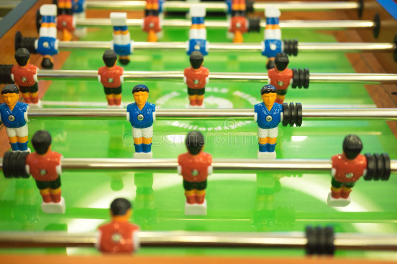 Football table soccer table football game soccer table. With red and blue players royalty free stock photos