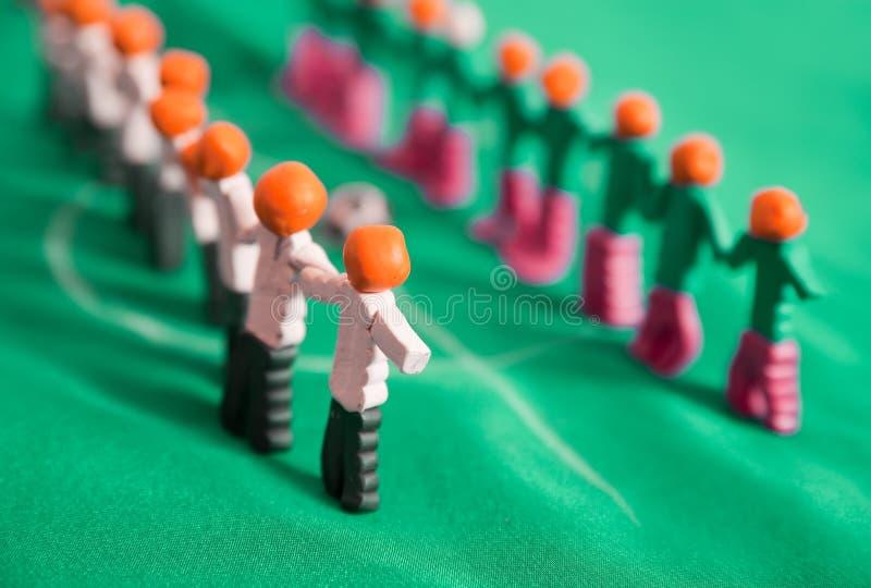 Football team from plasticine. Manikins of football team from plasticine on green fabric stock photo