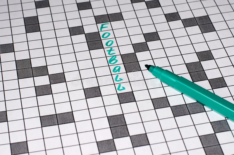 Football. Text in crossword. Green letters stock image