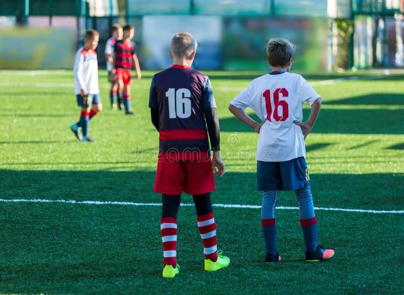 Football training soccer for kids. Boy runs kicks dribbles soccer balls. Young footballers dribble and kick football ball in game. royalty free stock images