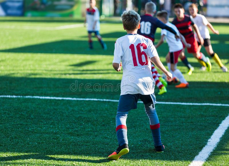Football training soccer for kids. Boy runs kicks dribbles soccer balls. Young footballers dribble and kick football ball in game. Training, active lifestyle stock photo