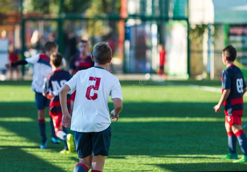 Football training soccer for kids. Boy runs kicks dribbles soccer balls. Young footballers dribble and kick football ball in game. Training, active lifestyle royalty free stock photography