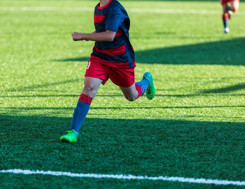 Football training soccer for kids. Boy runs kicks dribbles soccer balls. Young footballers dribble and kick football ball in game. Training, active lifestyle stock photography