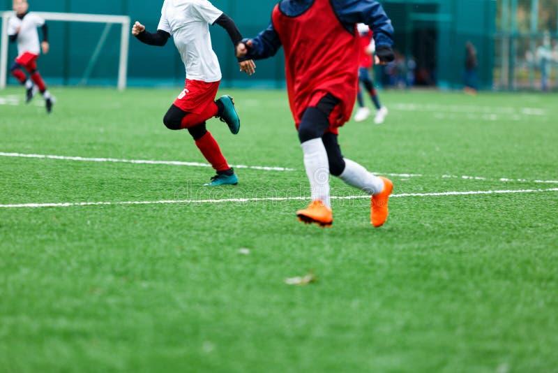 Football training soccer for kids. Boy runs kicks dribbles soccer balls. Young footballers dribble and kick football ball in game. Training, active lifestyle stock image