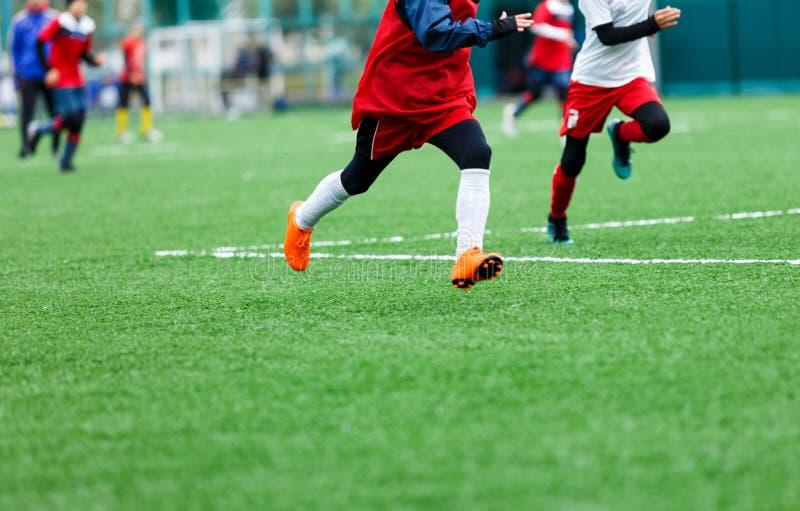 Football training soccer for kids. Boy runs kicks dribbles soccer balls. Young footballers dribble and kick football ball. In game. Training, active lifestyle stock photography