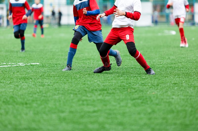 Football training soccer for kids. Boy runs kicks dribbles soccer balls. Young footballers dribble and kick football ball in game. Training, active lifestyle stock photos