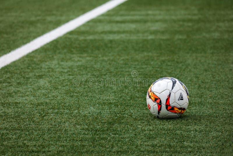 Football on turf in stadium