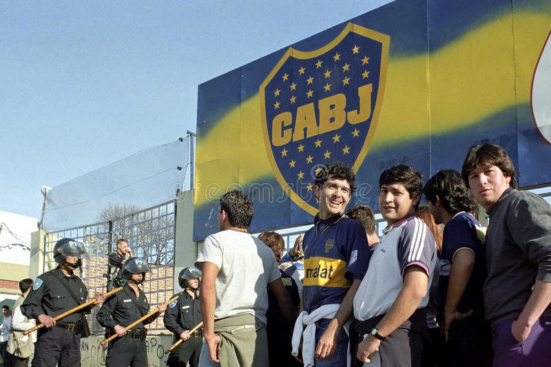 Football is war also in Argentina. Capital, city of Buenos Aires in the La Boca neighborhood: soldiers of the mobile unit, with baton, truncheons, in the attack stock image