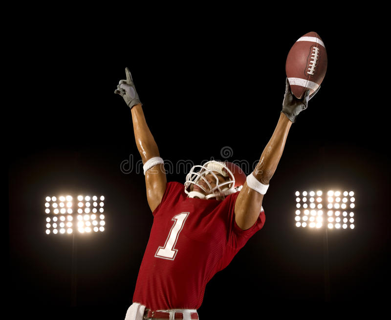 Football Win. Football player celebrates wining touchdown royalty free stock image