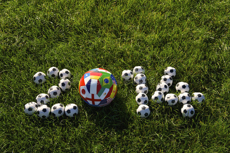 Football 2014 World Cup Teams Soccer Balls Green Grass. Message for 2014 World Cup featuring international teams football soccer balls in green grass field royalty free stock images
