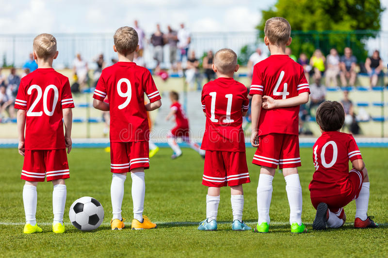 Football young boys team. Football soccer match for children. Young boys of football socce royalty free stock images