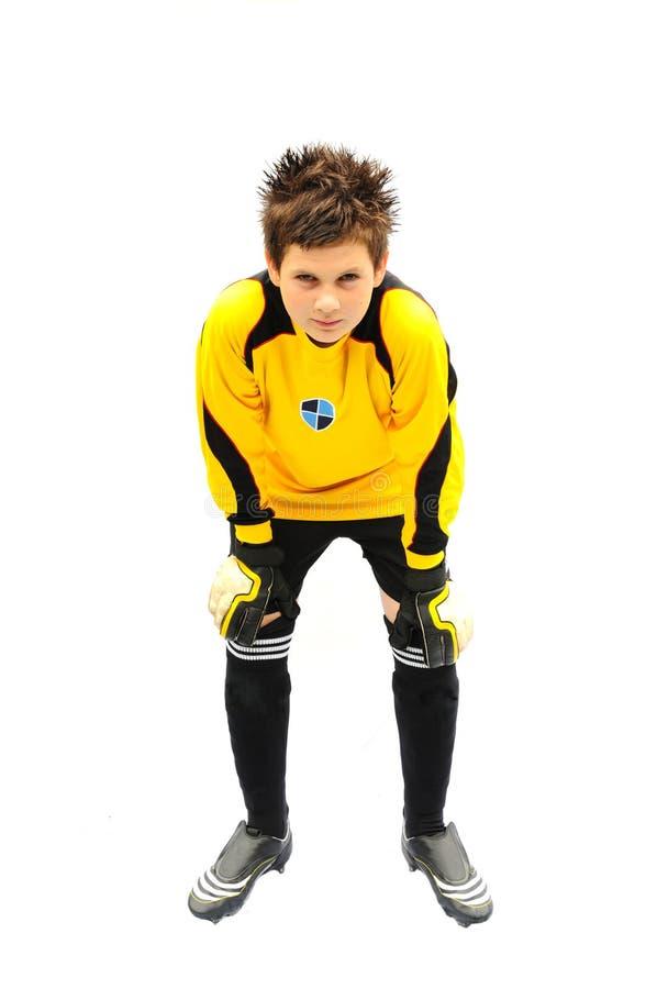 Footballer. Shot of a footballer isolated on white royalty free stock photos