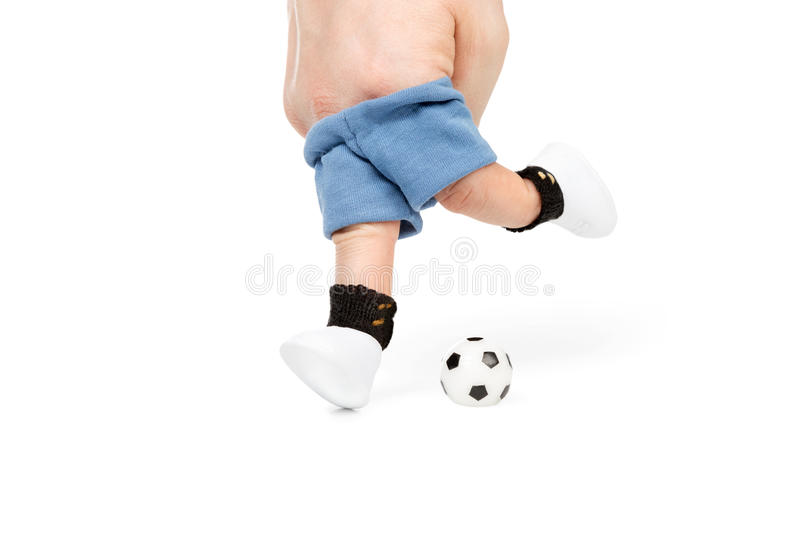Footballer of the fingers. Two fingers in sportswear kick the ball isolated on white background stock image
