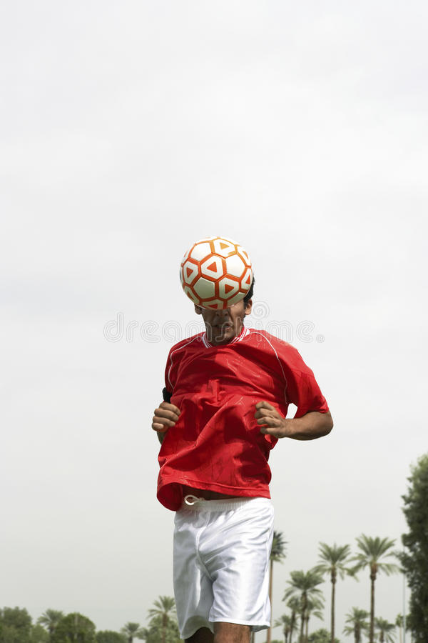 Footballer Heading The Ball