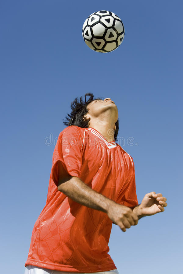 Download Footballer Heading The Ball Stock Image - Image: 29646707