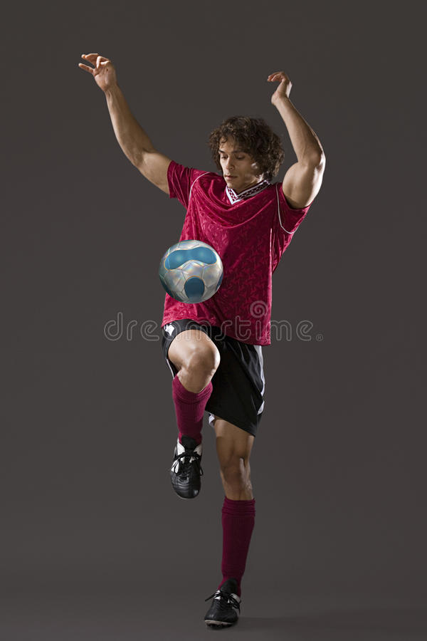 Footballer jouant uppy keepy image stock