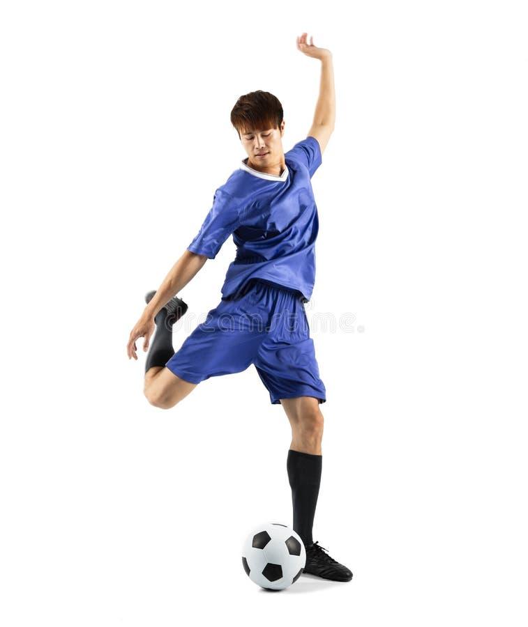 Footballeur à l'arrière-plan blanc d'isolement par action photos stock