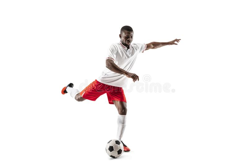 Footballeur africain professionnel du football d'isolement sur le fond blanc photo libre de droits
