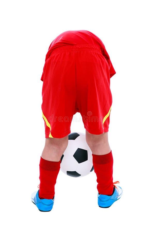Footballeur asiatique tenant son ballon de football, tir de studio Isolat photo stock
