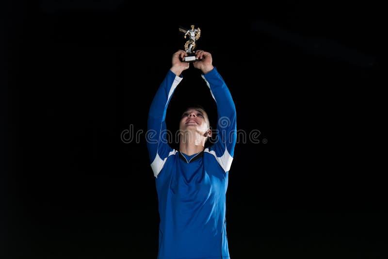 Footballeur célébrant Victory While Holding Win Coup photos stock
