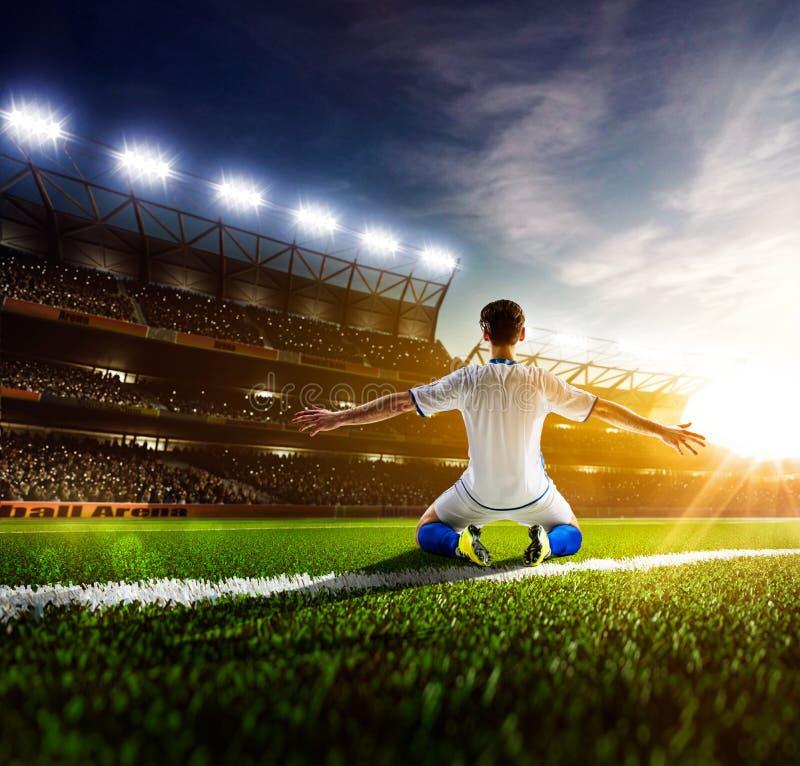 Footballeur dans le panorama d'action image stock