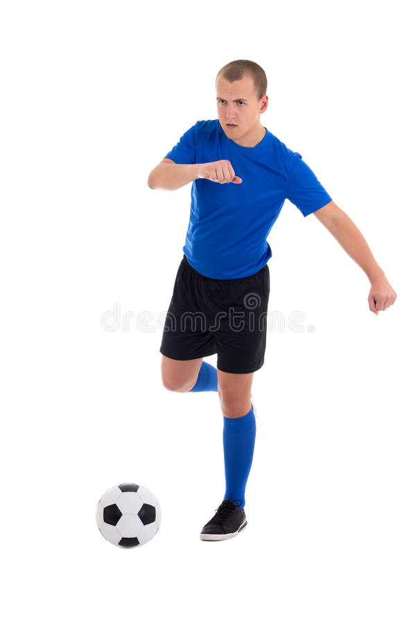 Footballeur donnant un coup de pied la boule d'isolement sur le fond blanc images libres de droits