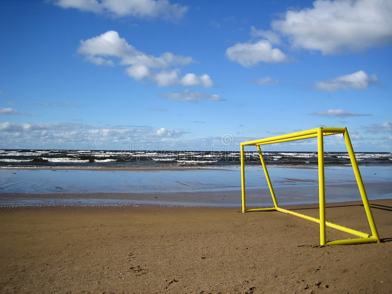 Footballs gates on a beach. royalty free stock image