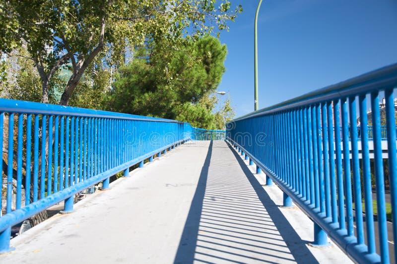 Footbridge with blue railing stock images