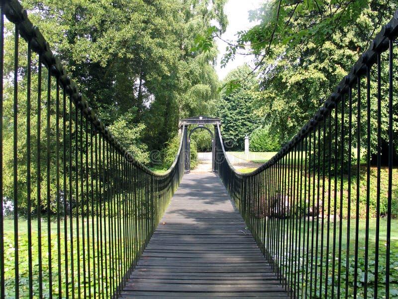 Footbridge in an estate Denmark. Steel footbridge in a country estate Denmark royalty free stock photography