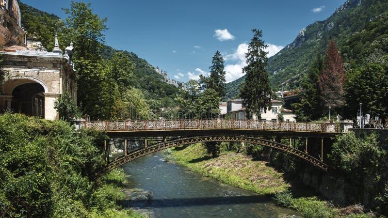 Footbridge over Cerna river in Baile Herculane stock image