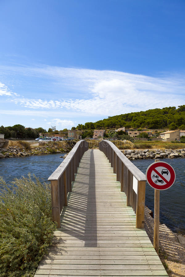 Footbridge over a pond in Gruissan. Southern France royalty free stock images