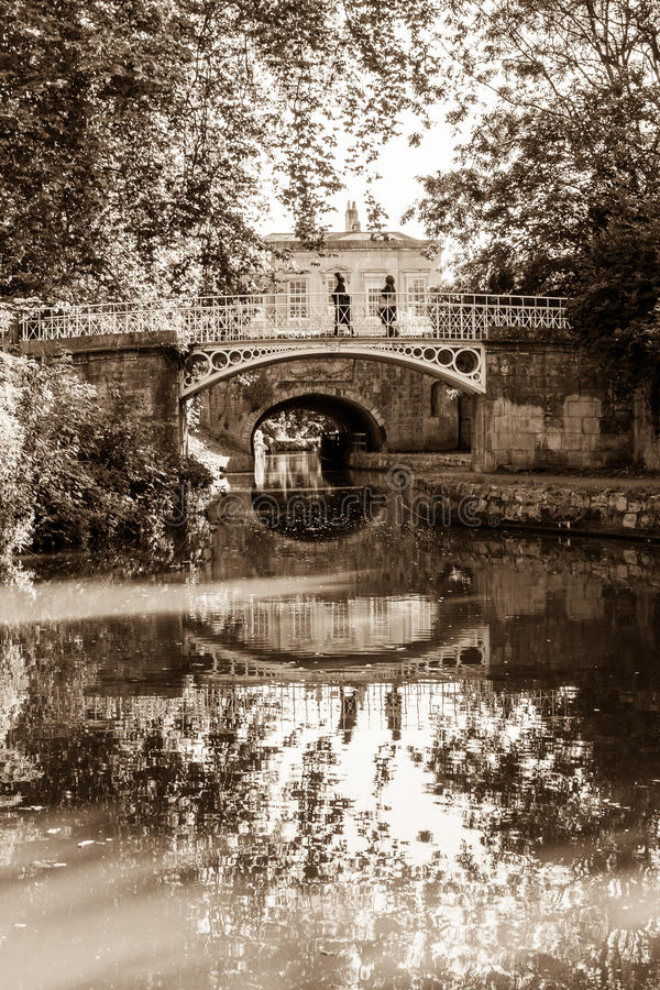 Footbridge over river Avon, Park at Bath. ENGLAND, BATH - 28 SEP 2015: Footbridge over river Avon, Park at Bath, sepia tone royalty free stock images