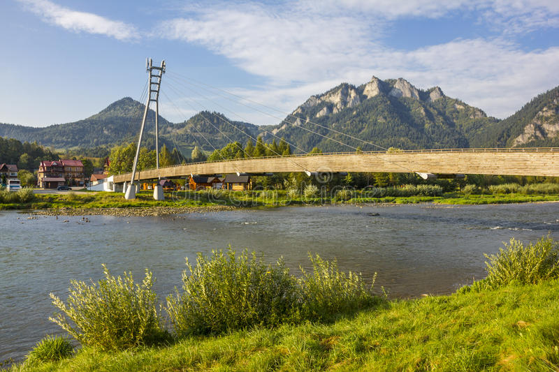Footbridge over the river Dunajec, Poland/Slovakia. Footbridge connecting two countries - Poland and Slovakia royalty free stock photography