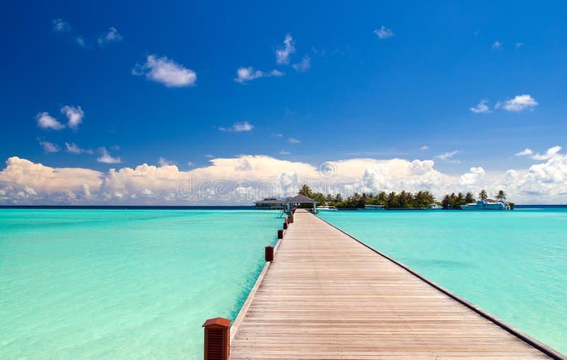 Footbridge over turquoise ocean stock images