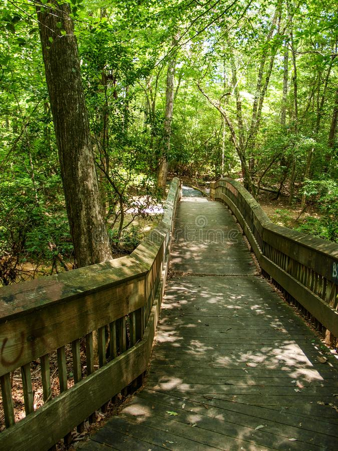 Footbridge over West Fork of the Little River. Hiking trail along the west fork of the Little River at Pisgah Covered Bridge in Randolph County, North Carolina royalty free stock photos