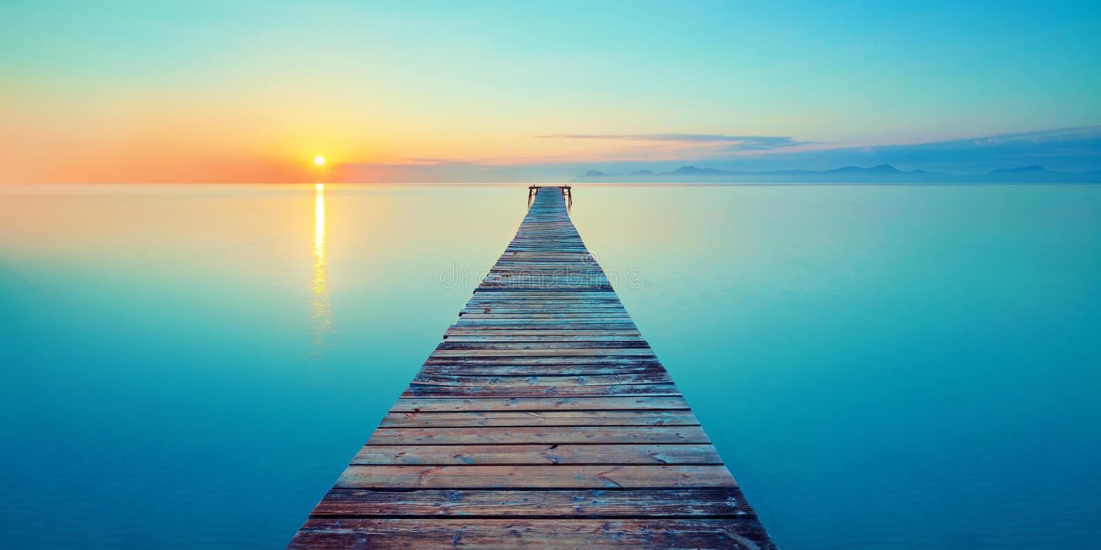 Footbridge sea beach meditation journey calm hormone sunset sea yoga stock photos