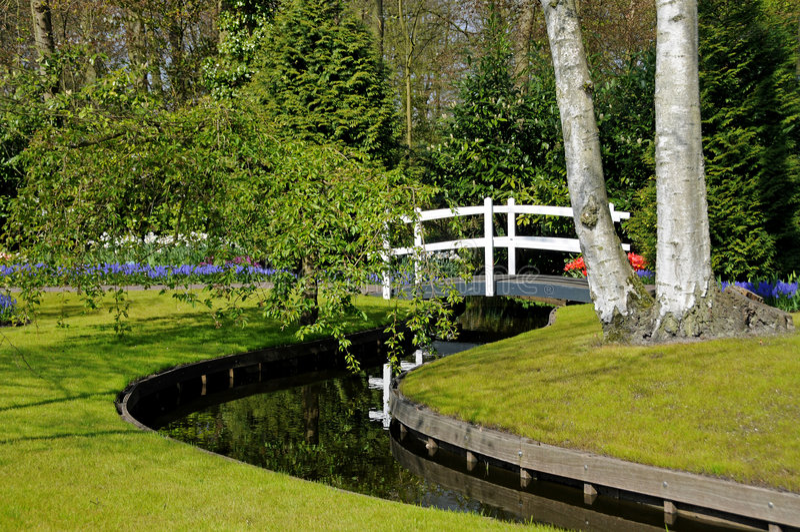 Footbridge In Spring Garden Royalty Free Stock Images