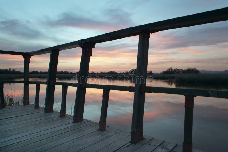 Footbridge walkway. Wetland landscape. Sunset. Tablas de Daimiel. Ciudad Real. Spain. royalty free stock photography