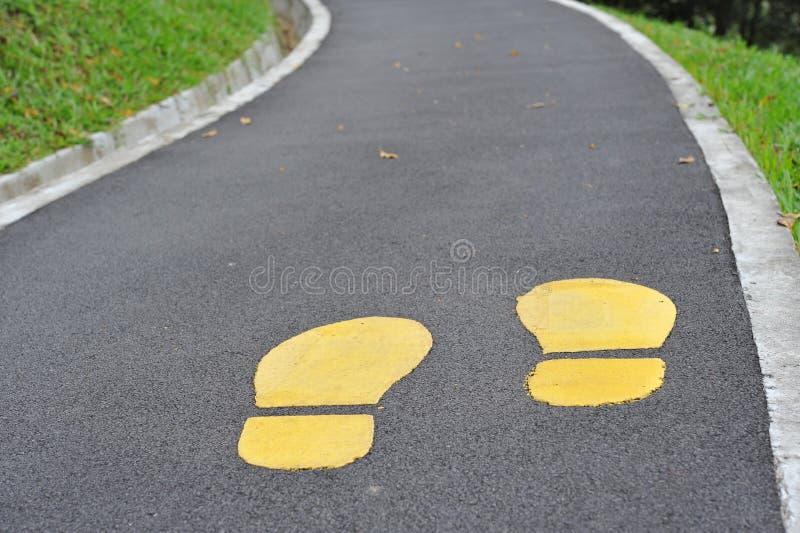 Footmarks amarelos foto de stock royalty free