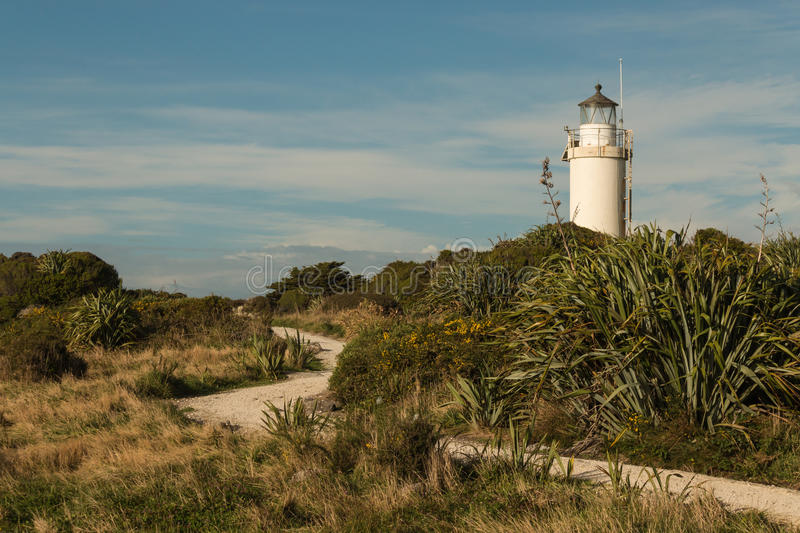 Footpath leading to Cape Foulwind lighthouse on West Coast stock photos