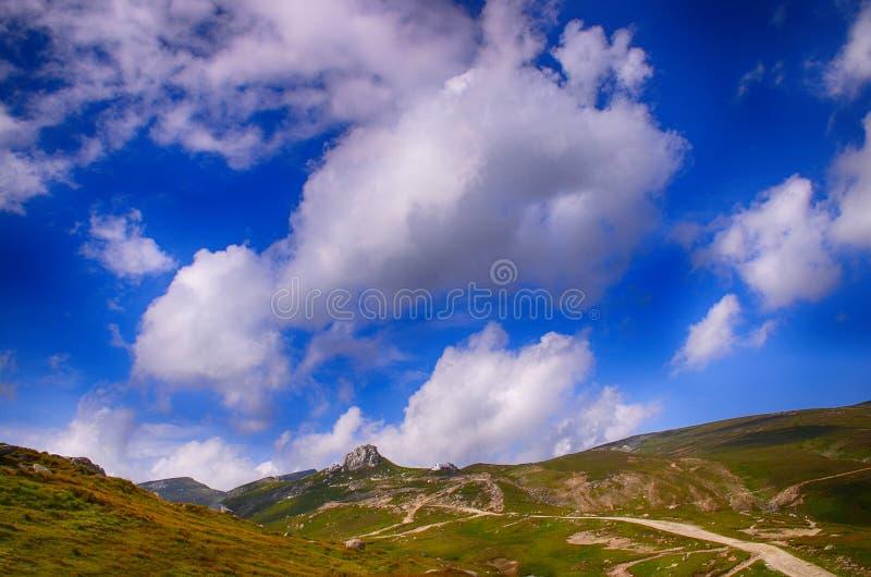 Footpath in the mountains - Bucegi - Romania. The Bucegi Mountains (Romanian: Munții Bucegi [ˈmunt͡sij buˈt͡ʃed͡ʒʲ] ( listen) stock photography