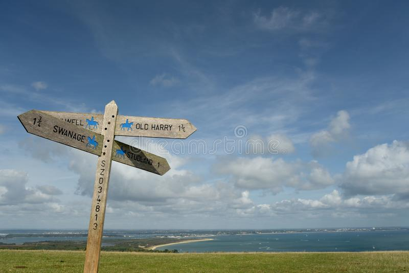 Sign on path above Old Harry Rocks on Dorset coast. Footpath sign on the path above Old Harry Rocks on the Dorset coast royalty free stock photos
