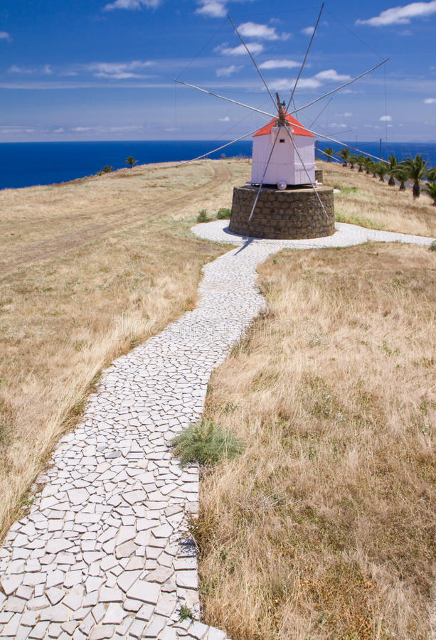 Footpath to Portuguese windmill stock photo