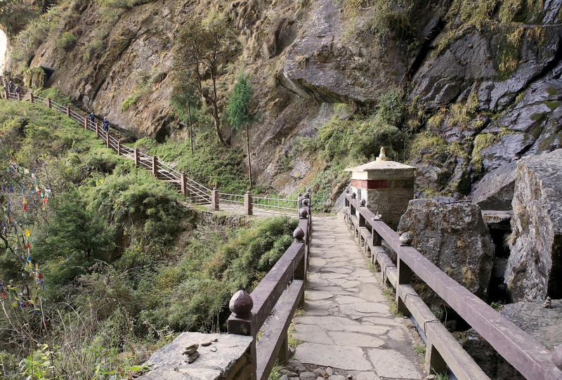 The footpath to the Tiger's Nest, Paro, Bhutan. Taktsang Palphug Monastery also known as Tiger's Nest is a prominent Himalayan Buddhist sacred site and temple stock photos