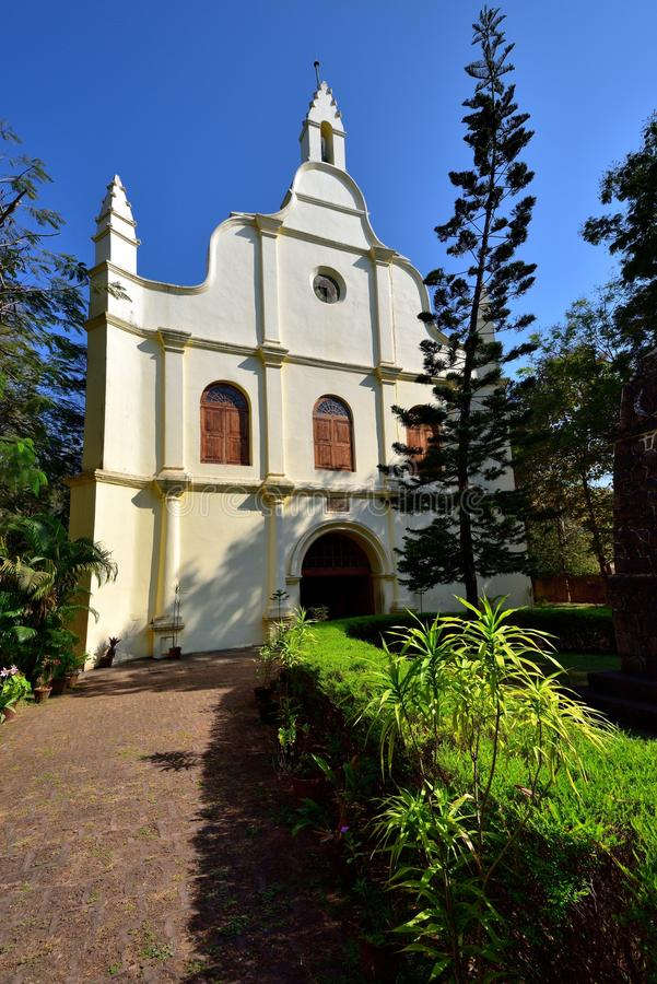 The footpath to the white church. White facade of St Francis Church, Fort Kochin, India royalty free stock photo
