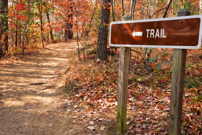 Footpath with Trail Sign in the Blue Ridge Mountains. Autumn landscape of a footpath with a trail sign in the Blue Ridge Mountains of north Georgia royalty free stock images