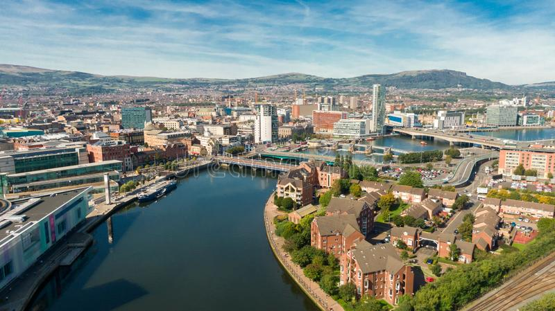 Aerial view of Belfast  in Northern Ireland at Night. Sunset above City, mountains or hills on backgroundFootpath between trees in stock photos