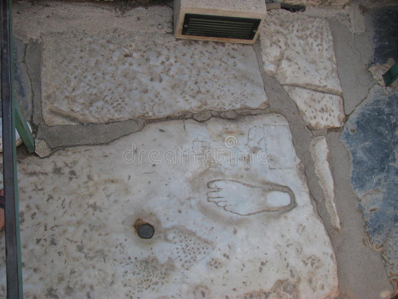 The first billboard in History, footprints in Ephesus izmir turkey. This footprint is considered billboards used for the first time in the world. Marble is stock photos