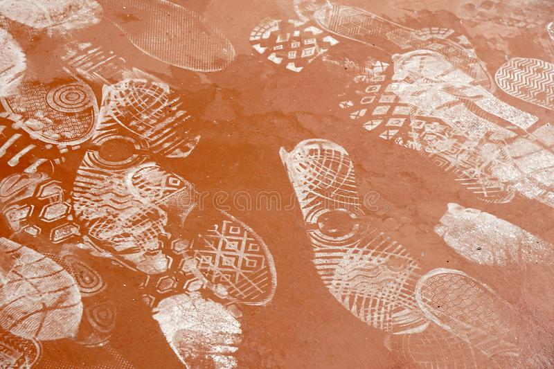 Footprint on dusty concrete or stone path royalty free stock photos
